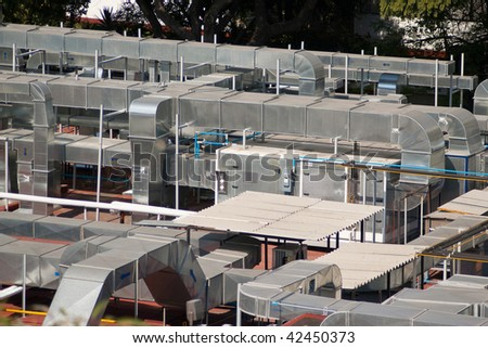 Shoot of roof of industrial, pipes and air conditioner - stock photo