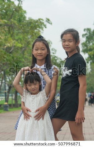 Shoot portrait of Asian children in public park outdoor.