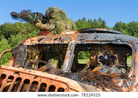 shooter and observer in a car wreck - stock photo