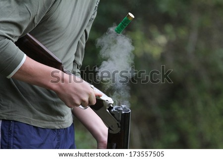 shooter gun discharged after the shot - stock photo