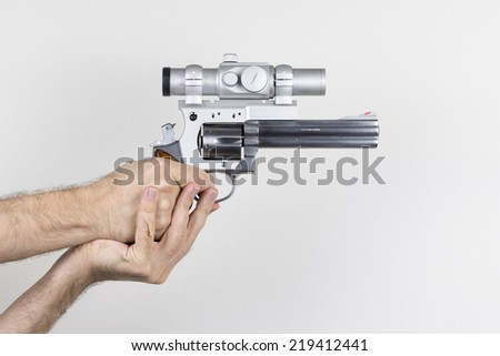 Shooter holds .357 Magnum revolver with dot sight - stock photo