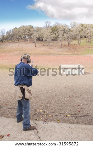 shooter ready for bird on trap house - stock photo