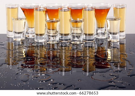 Shooters with whiskey, tequila and rum - stock photo