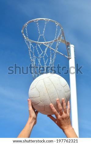 Shooting a Netball Goal - stock photo