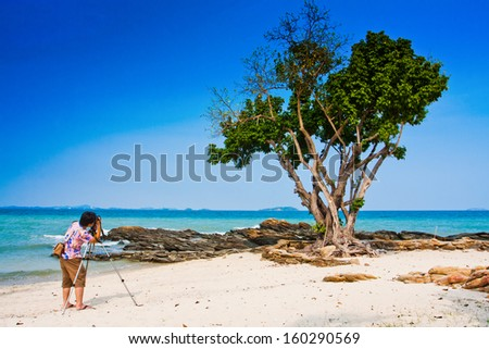 Shooting at the beach - stock photo