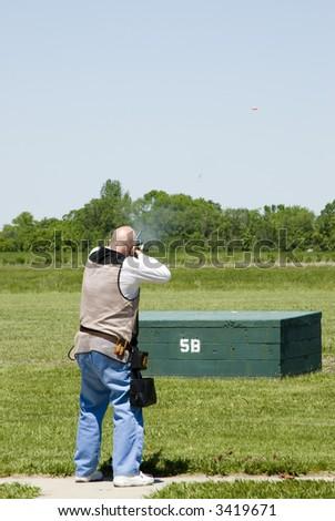 shooting clay pigeons at a trap shoot range - stock photo