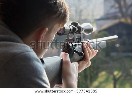 shooting from a airsoft rifle - stock photo