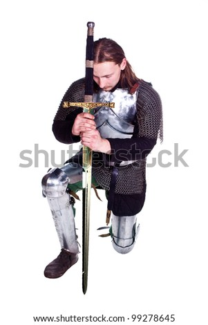 Shooting in a studio in the armor, and people with weapons. - stock photo
