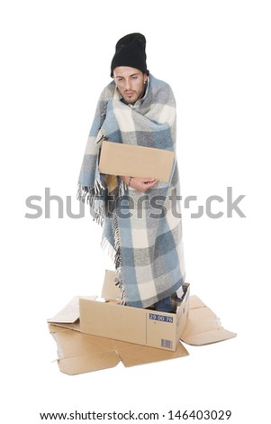 Shooting in studio Homeless in his cardboard begging with a sign - stock photo