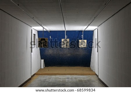 Shooting range in a dark indoor room - stock photo