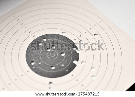Shooting shield with holes from shots of weapons - stock photo