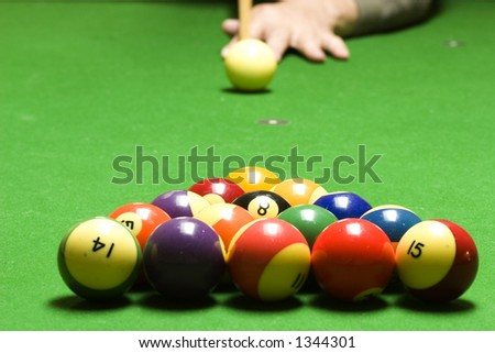 Shooting some pool - stock photo
