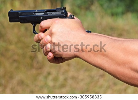 Shooting with a pistol - stock photo