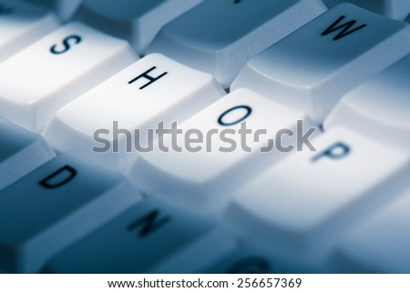 shop concept image on computer keyboard with lightray - stock photo