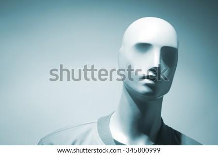 Shop dummy fashion mannequin in store boutique shop window artistic photo. - stock photo