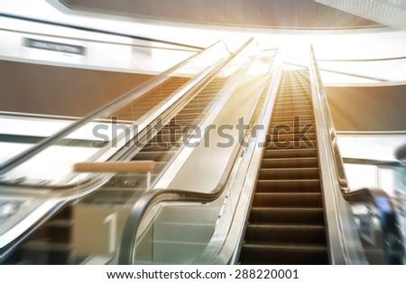 Shop escalator in shopping center - stock photo