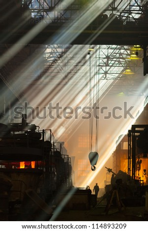 Shop foundry in rays of light - stock photo
