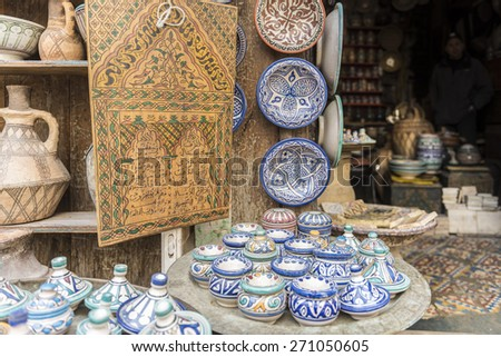 Shop of traditional pottery in Fes, Morocco, in the old medina - stock photo