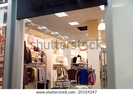 shop on the sale of modern youth and fashionable clothes - stock photo