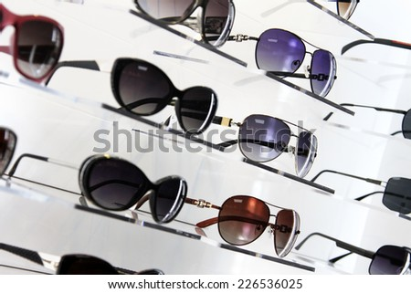 shop shelves with sunglasses - stock photo