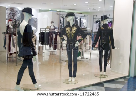 Shop window with three mannequins - stock photo