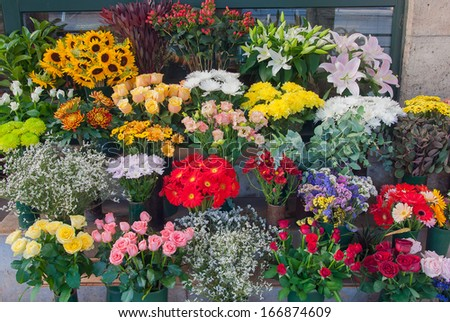 Shop with a variety of colorful spring flowers. - stock photo