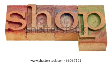 shop word in vintage wooden letterpress printing blocks isolated on white - stock photo