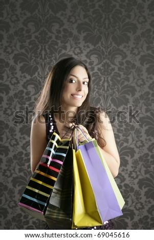 Shopaholic fashion woman colorful bags retro dark gray wallpaper - stock photo