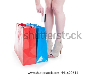 Shopaholic woman doing shopping and using credit or debit card to buy things isolated on white with advertising area