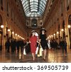 Shopaholics portrait in Galleria Vittorio Emanuele in Milan - stock photo