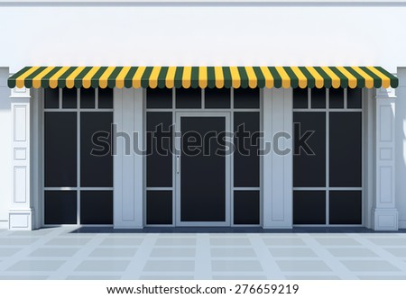 Shopfront in the sun - classic store front with awnings - stock photo