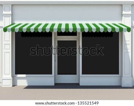 Shopfront in the sun - classic store front with green awnings - stock photo