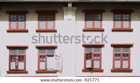 Shophouse windows in Chinatown, Singapore - stock photo