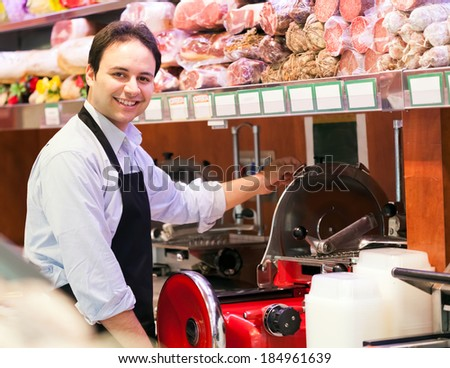 Shopkeeper at work in a grocery store - stock photo