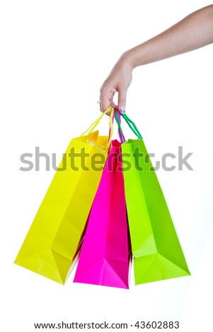 Shopper holding shopping bags, in bright spring colors.  Shot on white background. - stock photo