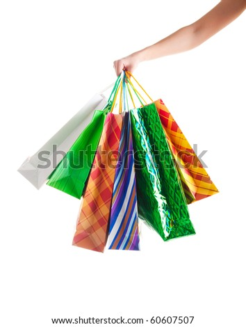 Shopper holding shopping bags. Shot on white background - stock photo