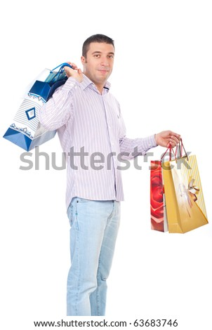 Shopper man carrying shopping bags and smiling isolated on white background - stock photo