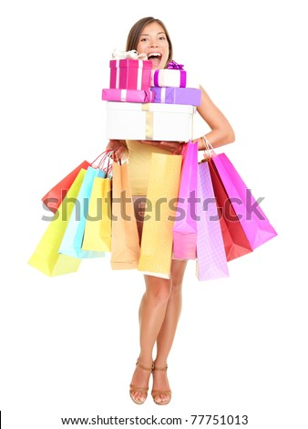 Shopper. Shopaholic shopping woman holding many shopping bags excited. Isolated portrait of young woman in full body on white background.