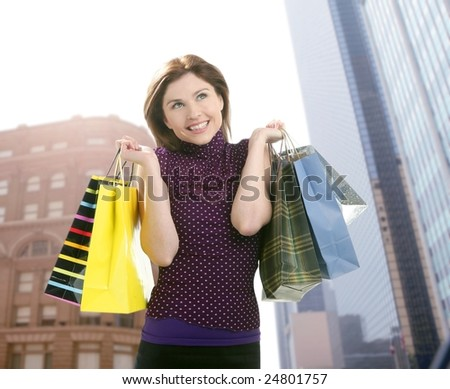 Shopper smiling woman shopping happy on the city [Photo Illustration] - stock photo