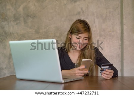 Shopper woman buying online on the smart phone