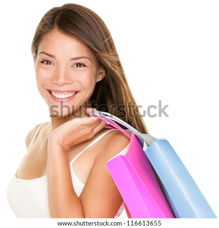 Shopper woman holding shopping bags. Shopper girl holding shopping bags smiling happy fresh. Beautiful cheerful mixed race Caucasian / Chinese Asian female shopping girl isolated on white background