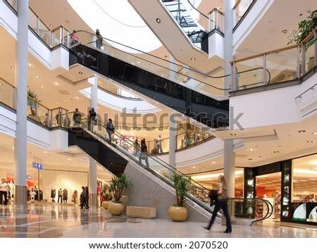 Shoppers at multilevel shopping center - stock photo
