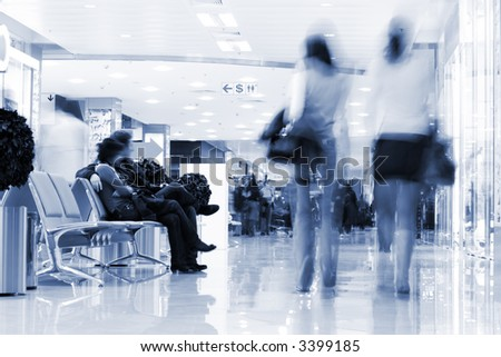 Shoppers at shopping center, motion blur. Tint blue