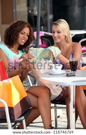 Shoppers in a cafe - stock photo