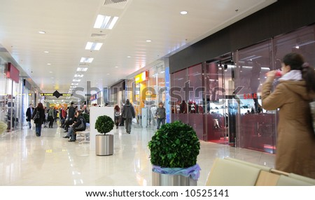 shoppers in store - stock photo