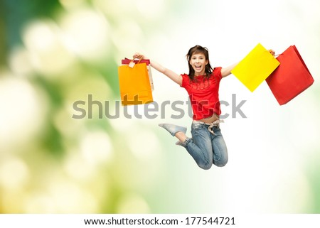 shopping and movement concept - happy girl with shopping bags - stock photo