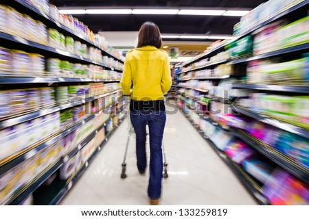 shopping at the supermarket,motion blur - stock photo