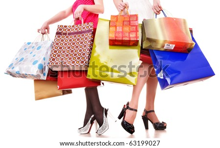 Shopping bag and group of leg in shoes. Isolated. - stock photo