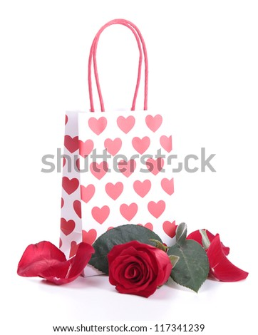shopping bag and red rose - stock photo