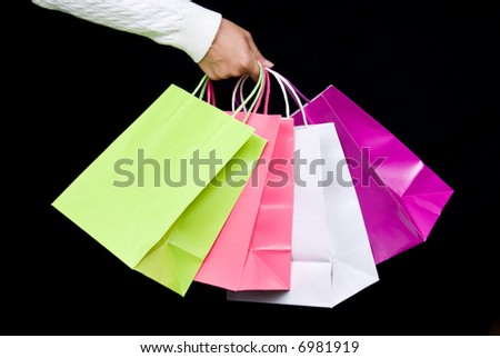 Shopping bag assortment against black background